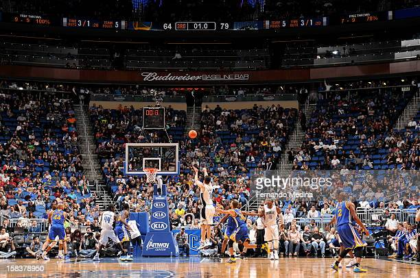 J Redick of the Orlando Magic shoots a long range shot with limited time on the clock as time expires in the third period against the Golden State...