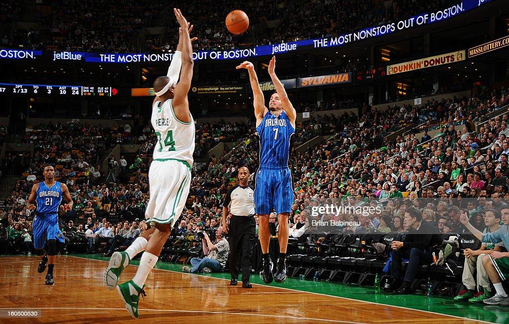 J.J. Redick #7 of the Orlando Magic shoots against Paul Pierce #34 of the Boston Celtics on February 1, 2013 at the TD Garden in Boston, Massachusetts.