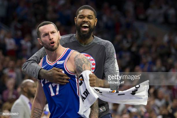 Redick of the Philadelphia 76ers celebrates with Amir Johnson after a made three point basket against the Indiana Pacers in the fourth quarter at the...