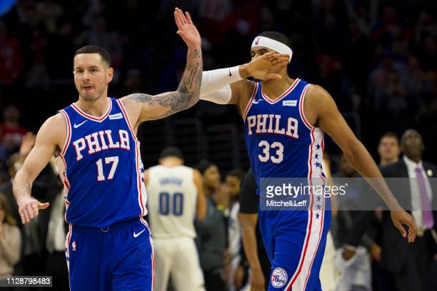 Redick of the Philadelphia 76ers high fives Tobias Harris against the Orlando Magic in the fourth quarter at the Wells Fargo Center on March 5 2019...