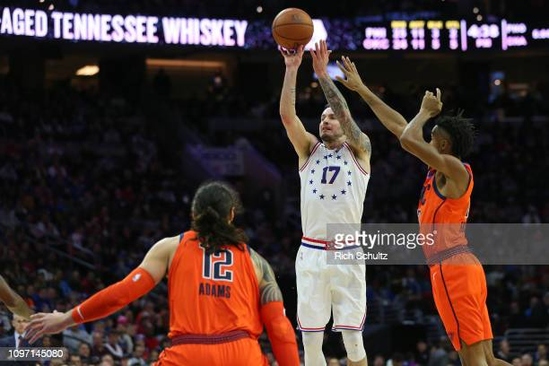 Redick of the Philadelphia 76ers in action against Steven Adams and Terrance Ferguson of the Oklahoma City Thunder during a game at Wells Fargo...