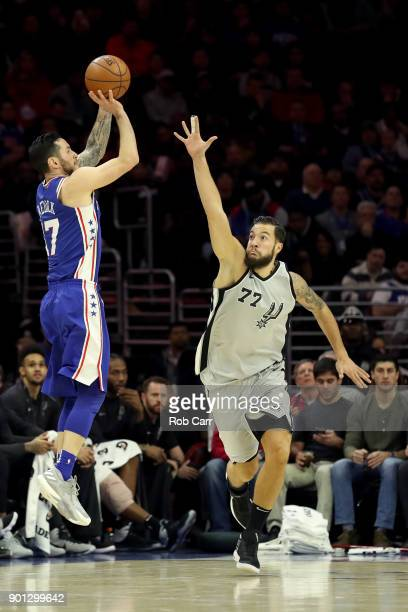 Redick of the Philadelphia 76ers puts up a shot over Joffrey Lauvergne of the San Antonio Spurs at Wells Fargo Center on January 3 2018 in...