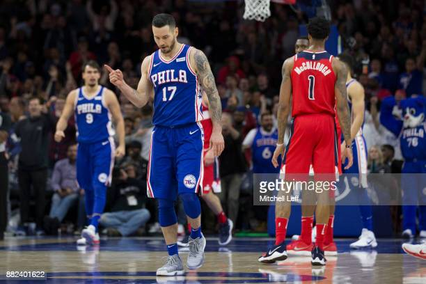 Redick of the Philadelphia 76ers reacts in front of Chris McCullough of the Washington Wizards after Dario Saric of the Philadelphia 76ers made a...