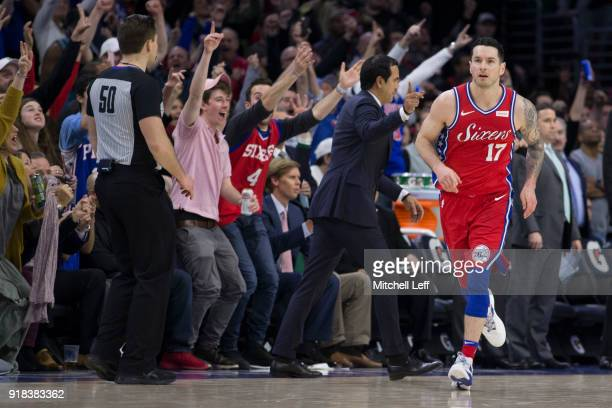Redick of the Philadelphia 76ers runs down the court as the fans react after a made basket in the fourth quarter against the Miami Heat at the Wells...