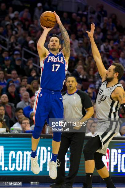 Redick of the Philadelphia 76ers shoots the ball against Marco Belinelli of the San Antonio Spurs at the Wells Fargo Center on January 23 2019 in...