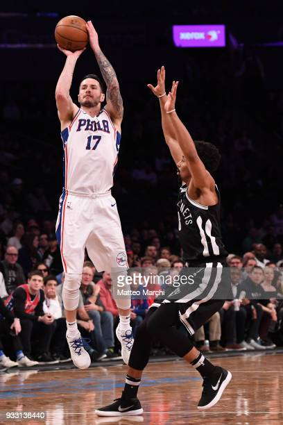 Redick of the Philadelphia 76ers shoots the ball against Spencer Dinwiddie of the Brooklyn Nets during the game at Barclays Center on March 11 2018...
