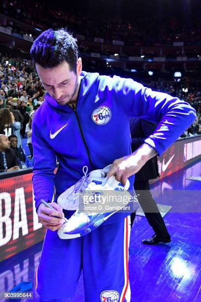 Redick of the Philadelphia 76ers signs a pair of shoes after the game against the Boston Celtics on January 11 2018 at The O2 Arena in London England...