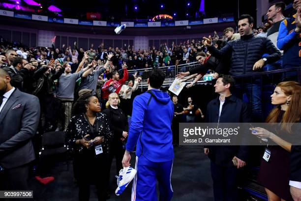 Redick of the Philadelphia 76ers tosses signed shoes into the crowd after the game against the Boston Celtics on January 11 2018 at The O2 Arena in...