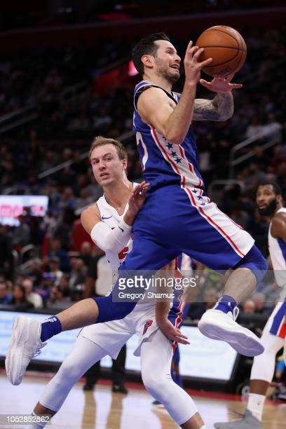 Redick of the Philadelphia 76ers tries to get a shot off next to Luke Kennard of the Detroit Pistons during the first half at Little Caesars Arena on...