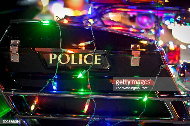 Redlands police motorcycle is decorated with lights for the 2015 Redlands Christmas Parade. 2015 Redlands Christmas Parade Saturday Dec. 5, 2015 in...