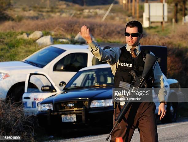 Redlands police officer secures at a blockade during a manhunt for the former Los Angeles Police Department officer Christopher Dorner who is...