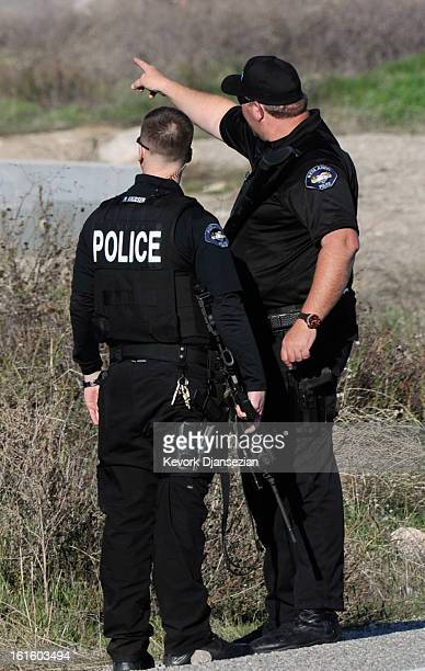 Redlands police officers at a blockade during a manhunt for the former Los Angeles Police Department officer Christopher Dorner who is suspected of...