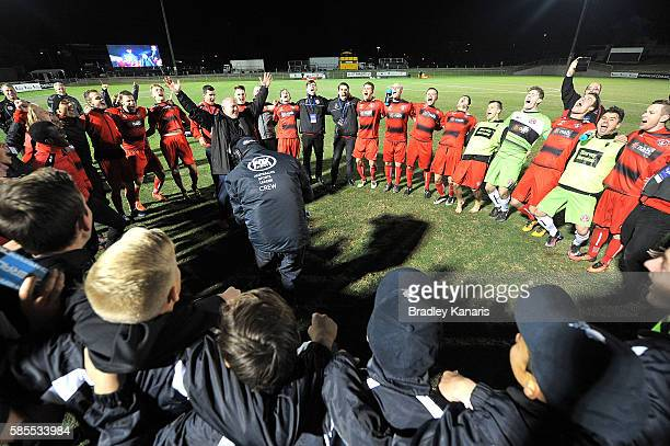 Redlands United celebrate their victory after the FFA Cup round of 32 match between Redlands United and Adelaide United at Perry Park on August 3...