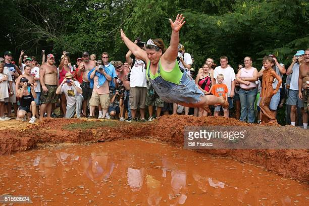 Redneck Games 12th Annual Summer Games Barbara Bailey aka 'Redneck Granma' diving during Mud Pit Belly Flop event at Buckeye Park East Dublin GA...