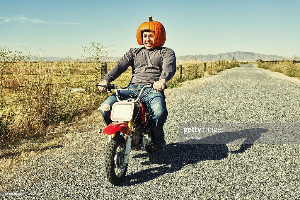 Redneck Pumpkin Motorcycle Racer : Stock Photo