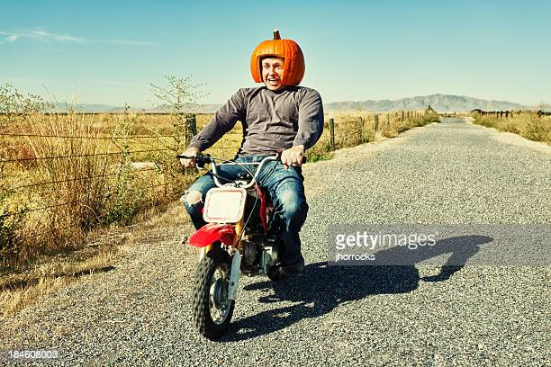 redneck pumpkin motorcycle racer - redneck stock photos and pictures