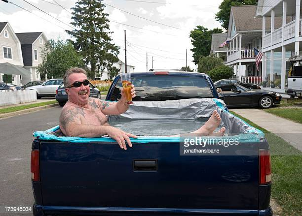redneck swimming pool, man relaxing in pick-up truck - redneck stock photos and pictures