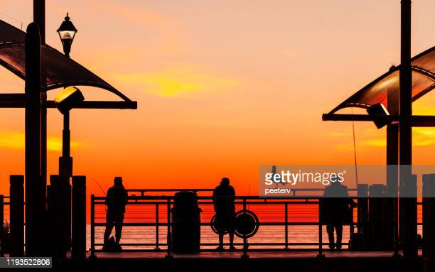 redondo beach pier sunset, california - redondo beach california stock pictures, royalty-free photos & images