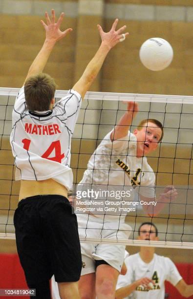 BEACH 05/03/11 Redondo vs Mira Costa boys volleyball Redondo's Ryan Mather can't block Keith Waddell's spike