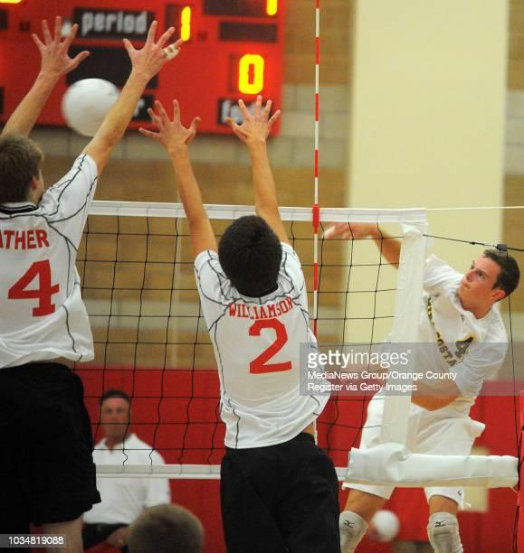BEACH 05/03/11 Redondo vs Mira Costa boys volleyball Ryan Mather and Nick Williamson block Chris Orenic