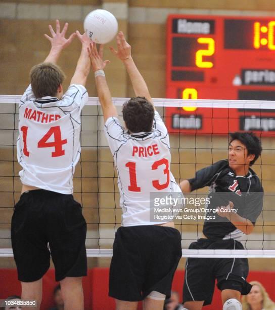 Scott Varley Redondo vs Palos Verdes boys volleyball Redondo's Ryan Mather left and Andy Price block Brendan Hong's spike