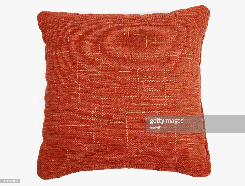 Red-orange square couch pillow with yellow design  : Stock Photo