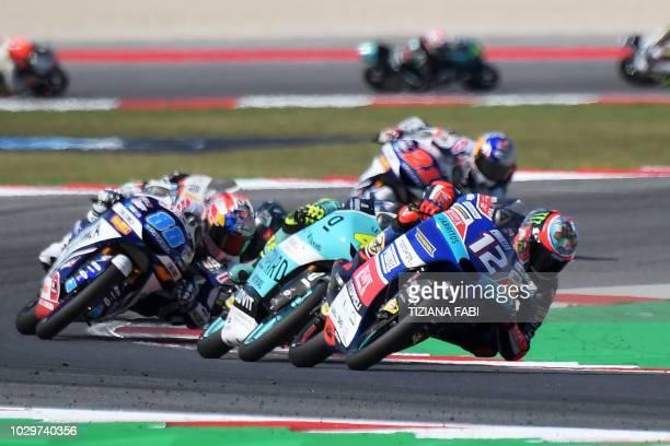Redox Pruestel GPs Italian rider Marco Bezzecchi leeds over Del Conca Gresini Moto3's Spanish rider Jorge Martin and Leoperd Racing's rider Italian...