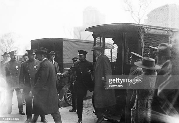 Reds and Bolsheviks arrested in raid in New York City, photographed leaving police wagons on the way to Ellis Island, where they will be held pending...