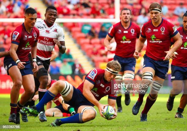 Reds' Angus ScottYoung dives onto a loose ball during the Super Rugby match between Australia's Queensland Reds and South Africa's Golden Lions in...