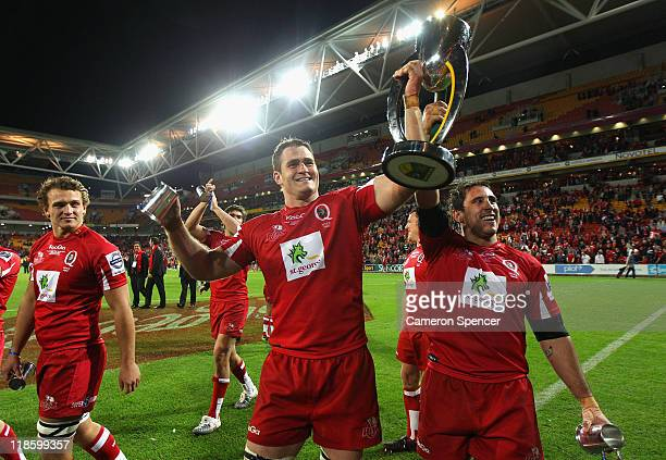 Reds captain James Horwill and team mate Ben Daley celebrate with the trophy after winning the 2011 Super Rugby Grand Final match between the Reds...