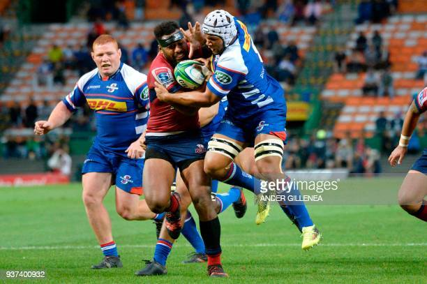 TOPSHOT Reds center Samu Kerevi fights off Stormers forward Nizaam Carr during the Super Rugby clash match between Stormers and Reds at the Newlands...