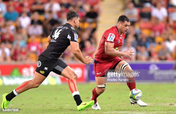 Reds player George Smith kicks the ball during the round one Super Rugby match between the Reds and the Sharks at Suncorp Stadium on February 24 2017...