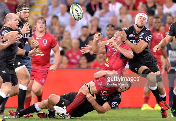 Reds player George Smith offloads during the round one Super Rugby match between the Reds and the Sharks at Suncorp Stadium on February 24 2017 in...