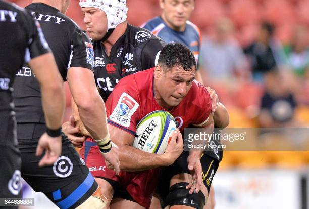Reds player George Smith takes on the defence during the round one Super Rugby match between the Reds and the Sharks at Suncorp Stadium on February...