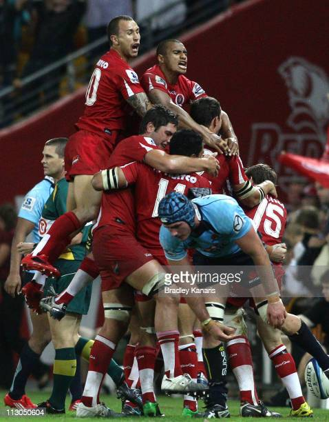 Reds players celebrate victory after the round 10 Super Rugby match between the Reds and the Waratahs at Suncorp Stadium on April 23 2011 in Brisbane...