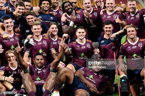 Reds players celebrate victory after the round one Super Rugby AU match between the Queensland Reds and the New South Wales Waratahs at Suncorp...