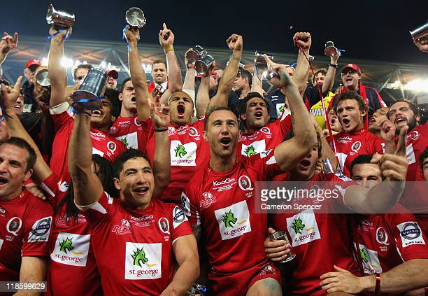 Reds players sing their team song after winning the 2011 Super Rugby Grand Final match between the Reds and the Crusaders at Suncorp Stadium on July...