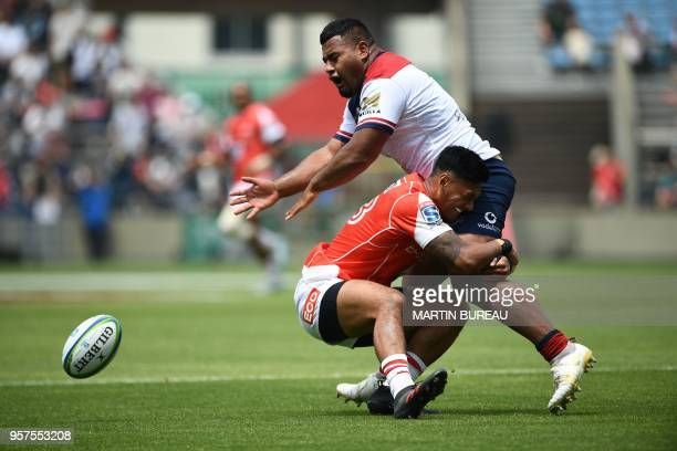 Reds' prop Taniela Tupou is tackled by Sunwolves' centre Timothy Lafaele during the Round 13 Super Rugby match between the Sunwolves of Japan and the...