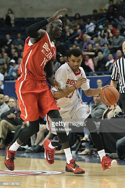 TORONTO APRIL 14 Red's Thon Maker tries to get ahead of a fast breaking Jamal Murray during a fast break The Biosteel All Canadian basketball game...