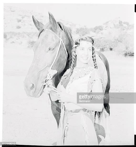 A Redskin for real and reel fullblooded Indian actress Kim Winona plays the tribal maiden on CBSTV's Brave Eagle show Kim's an expert rider having...
