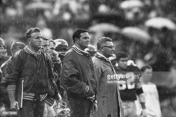 Redskins Coach Vince Lombardi standing on sidelines as light rain falls during game with Cleveland Browns at R F K Memorial Stadium