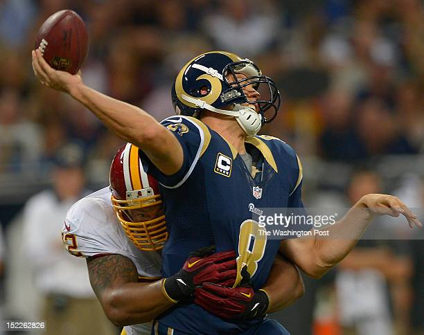 Redskins defensive end Stephen Bowen left drills Rams' quarterback Sam Bradford just as he releases an incomplete 2nd quarter pass as the St Louis...