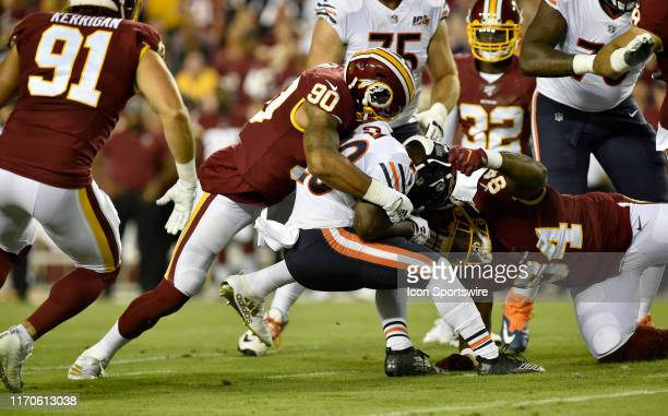 Redskins LB Montez Sweat and DT Daron Payne tackle Bears RB Tarik Cohen during the Chicago Bears vs Washington Redskins Monday Night Football game...