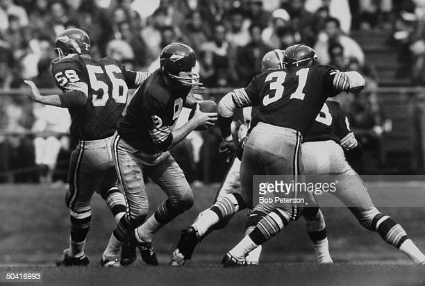 Redskins quarterback Sonny Jurgensen running with ball during Cleveland Browns game at R F K Memorial Stadium
