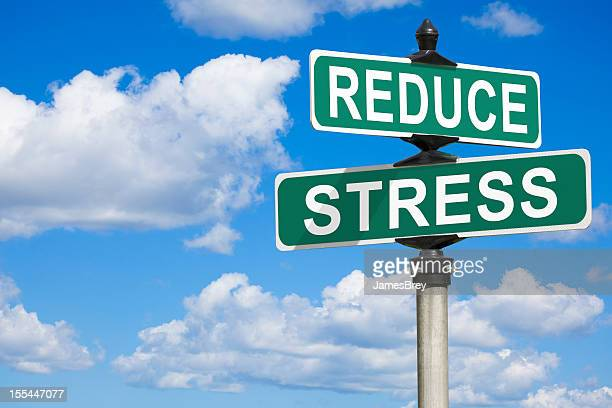reduce stress street sign - decline stock pictures, royalty-free photos & images
