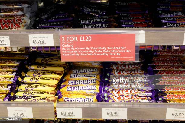 Reduced price deal is seen advertising chocolate confectionery in a shop on July 27, 2020 in Birmingham, United Kingdom. The British government plans...