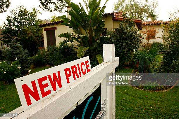 A reduced price sign sits in front of a house November 27 2007 in Glendale California US home prices plummeted 45 percent in the third quarter from...
