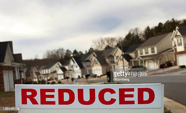 A reduced sign is displayed in front of a house for sale outside of Greensboro North Carolina US on Monday Feb 13 2012 The National Association of...
