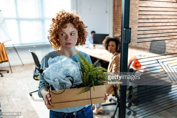 redundant businesswoman leaving office with box - being fired photos stock pictures, royalty-free photos & images