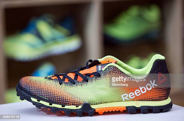 Reebok All Terrain Sprint running shoe, produced by Reebok, a unit of Adidas AG, sits displayed for sale inside a sports trainer store in London,...